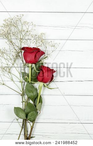 Red Roses On Old Wooden Planks With Copy Space