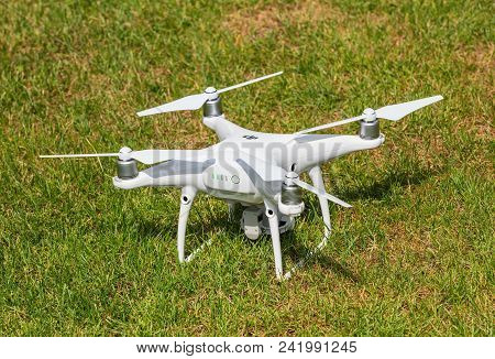 Wallisellen, Switzerland - May 22, 2018: a DJI Phantom 4 Pro drone standing on green grass, rear view, focus on  the drone. Phantom 4 Pro is a consumer drone, designed and manufactured by the DJI company.