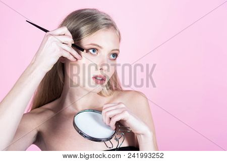 Beautiful Girl Applying Cosmetic With Eyeliner. Sexy Girl With Long Blonde Hair Applying Pencil For