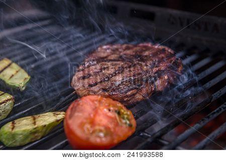 Steak Ribeye And Grille Vegetables Being Prepared In Josper