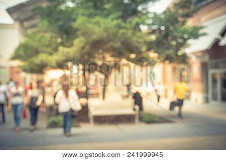 Vintage Blurred People Shopping At Outlet Mall In America