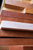 Stacked wooden planks. Wood body planks used for electric guitar building. poster