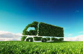 Eco Friendly Transportation Concept. 3d Rendering Of Green Green Truck Icon On Fresh Spring Meadow W