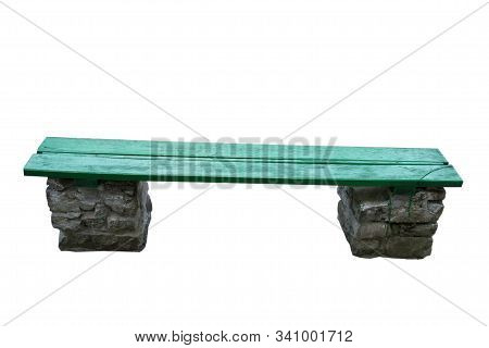 Isolated Bench With Green Boards And Stone Legs.