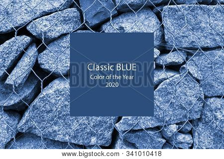 Gabion Wall Closeup. Textured Background. Gabion Is Stones In Wire Mesh Used For Erosion Control And