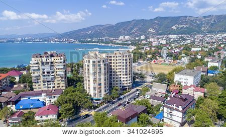 Multi-storey Residential Buildings On The Shore Of Gelendzhik Bay. Aerial View. Visible Sea, Mountai
