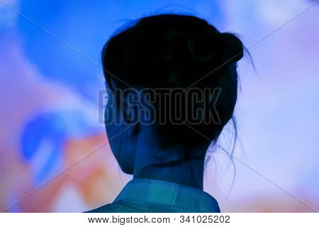 Back View - Woman Standing In Front Of Interactive Display And Looking Around At Modern Immersive Ex