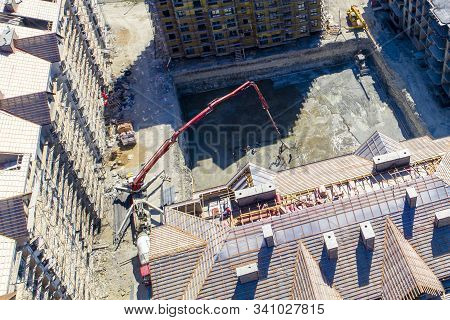 Construction Of A Multi-storey Residential Complex. Aerial View. Pouring Concrete Foundation Of One