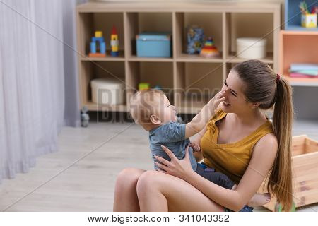 Teen Nanny Playing With Cute Little Baby At Home
