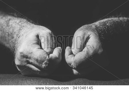Close-up Of Two Hands Pressing Their Thumbs In Black And White