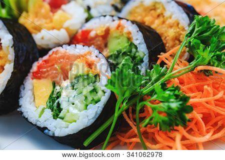 Varied Sushi With Cucumber Maki, Korean Carrot, Parsley, Sea Cabbage And Salmon Maki. Japanese Sashi
