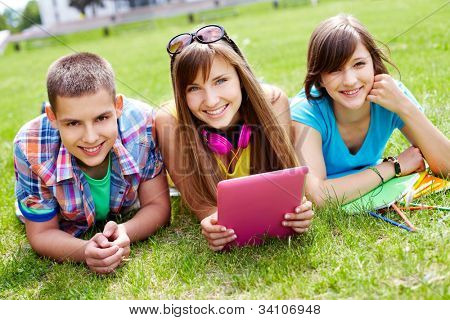 Portrait of three college students enjoying their free time outdoors