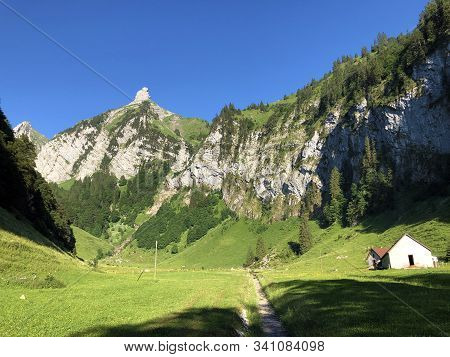 Traditional Architecture And Farmhouse In The Valley Of Wagital Or Waegital And By The Alpine Lake W