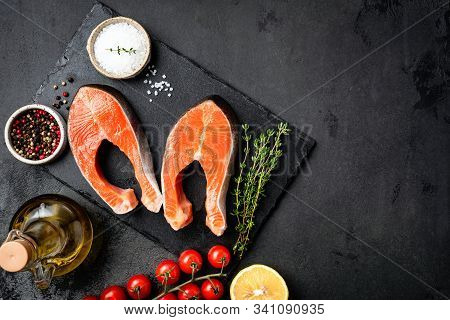 Salmon Steaks, Spices And Herbs For Cooking On Black Slate. Rich In Omega 3 Fatty Acids Healthy Food