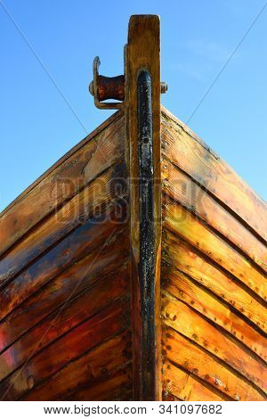 Prow Of Restored Old Boat Lacquer On Timber.