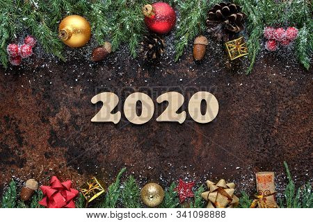 Christmas Or New Years Eve Festive Background With Wooden Numbers 2020 And Christmas Decorations On