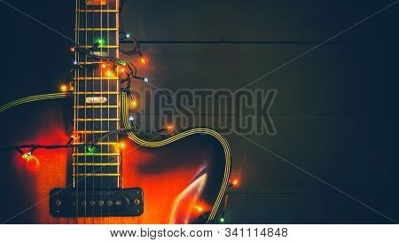 Old, Jazz Electric Guitar With A Luminous Garland. New Year Greeting Card For Musician, Guitarist. F