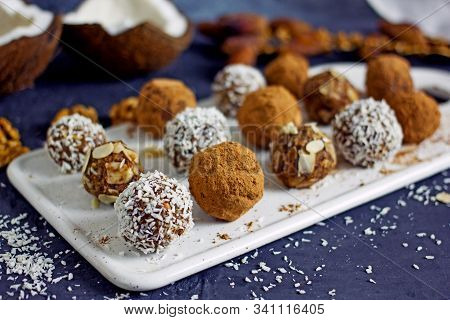 Raw Food Candy Balls. Handmade Vegan Sweets Made Of Almonds, Walnuts, Dates, Coconut And Cocoa. Raw