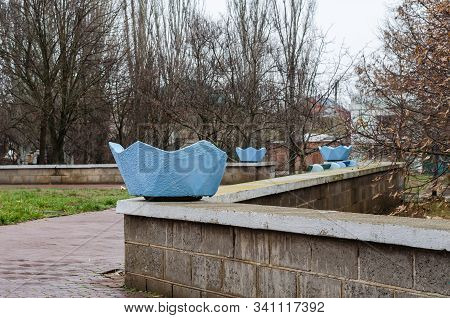 Stone Flower Bed. Empty Flower Bed On The Parapet. A Fenced Recreation Area In The City. Overcast Da