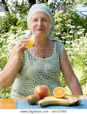 Woman drinks fresh orange juice