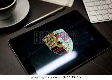New York, New York / USA - 11 11 2019: Logo of Porsche on the iPad Air2 in on office desk
