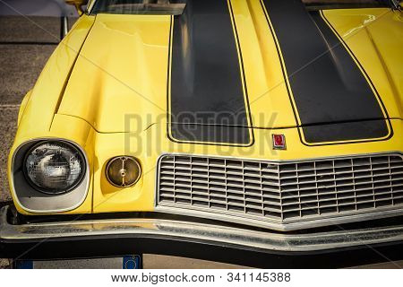 Alghero, Italy - April 08, 2018: Front View Of A Yellow Classic Chevrolet Camaro At American Motor F