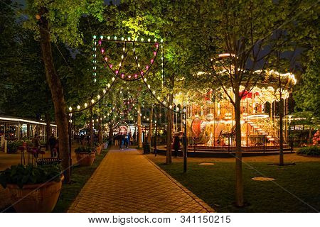 Vintage Carousel In Tivoli Gardens, Amusement Park In Copenhagen