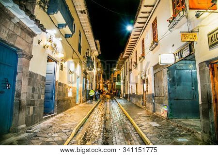 Cusco, Peru - Jan 6, 2019: Historic Colonial Buildings on the Plaza de Armas Square with Many Visitors at Night, Cusco, Peru, South America,