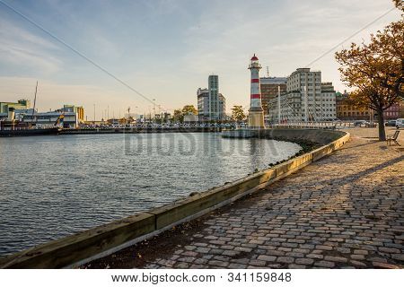 Malmo, Sweden: Beautiful White Lighthouse With Red Stripes. City In Scania County And Oresund Region