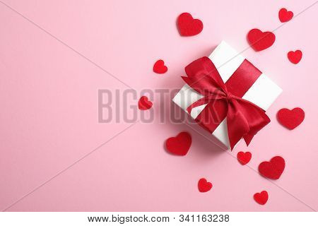 Happy Valentine's Day Card Mockup. White Gift Box With Red Ribbon Bow And Red Hearts On Pink Backgro