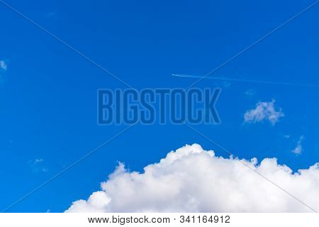 Jet Airplane Flying Over A Soft White Cloud In Italy