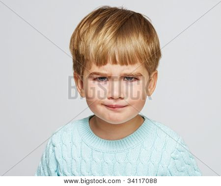 Funny baby boy in blue pullover portrait