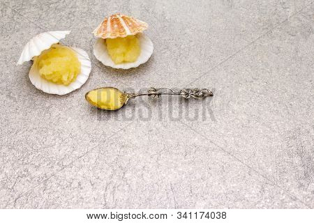 Capelin Roe In Seashells. Lightly Salted Caviar Snack In Silver Spoon On A Stone Background