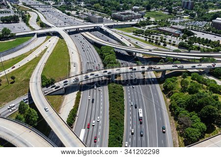 Aerial view of Interstate 85 and Interstate 20 interchange bridges and ramps in Atlanta Georgia.