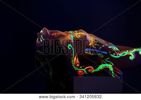 Woman With Uv Color Pattern Bodyart In The Dark