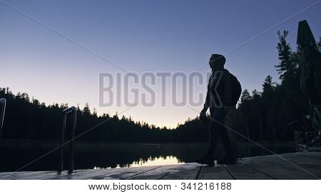 Silhouette Traveler Photographing Scenic View In Forest, River. Wood Pier. One Woman Shooting Nice D