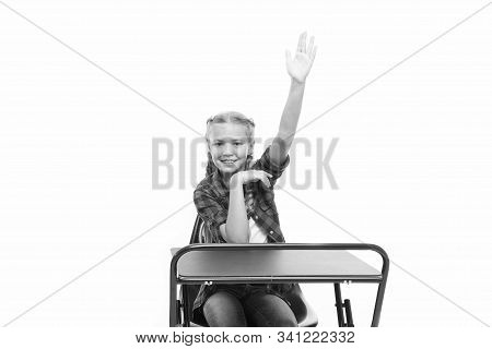 Dedicated To Education. Small Girl Raising Hand In School Of Primary Education. Little Child Getting