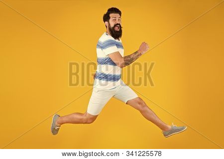 Hurry Up. Summer Vacation. Man Bearded Hipster With Mustache Long Beard Running Yellow Background. G