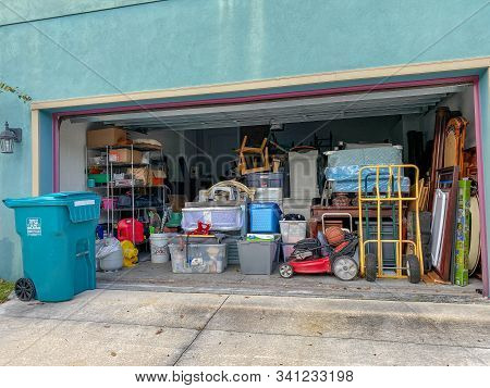 Orlando,fl/usa-11/13/19:  An Unorganized Garage Filled With A Lot Of Stuff In A Neighborhood.