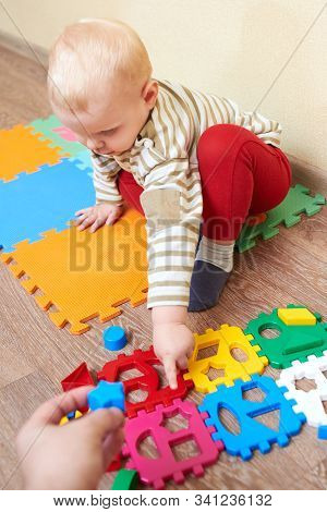 Dad Gives The Child A Figure For Folding Sorter Toys, Educational Games For Children.