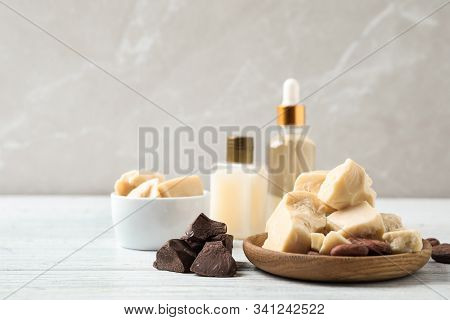 Organic Cocoa Butter On White Wooden Table