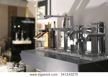 New Shiny Faucets In Bathroom Fixtures Store. Total Wholesale