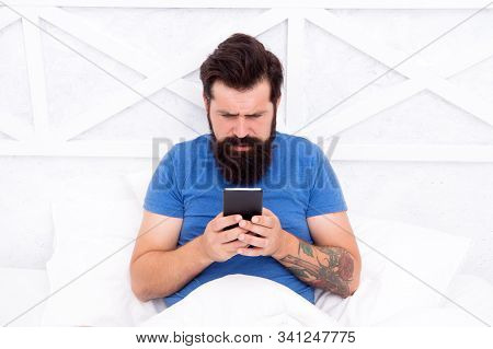 Good Morning Sms. Bearded Man Texting Sms In Bed. Hipster Send Sms Using Smartphone. Sms Message. Sh