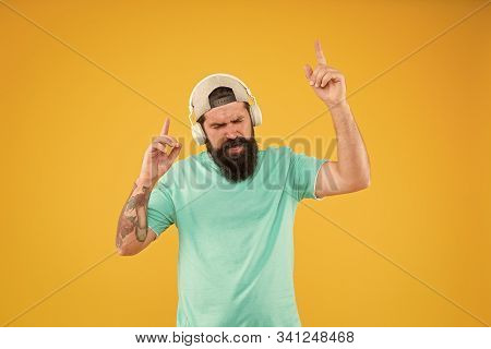 New Disco Party Hit. Dj Man On Yellow Background. Unshaven Guy Enjoying Tune Playing At Dj Party. Be