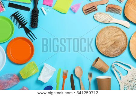 Flat Lay Composition With Household Goods On Light Blue Background, Space For Text. Recycling Concep