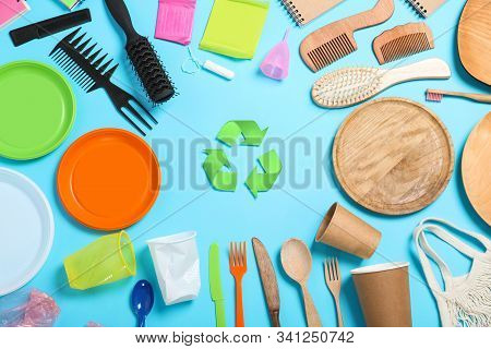 Recycling Symbol And Household Goods On Light Blue Background, Flat Lay