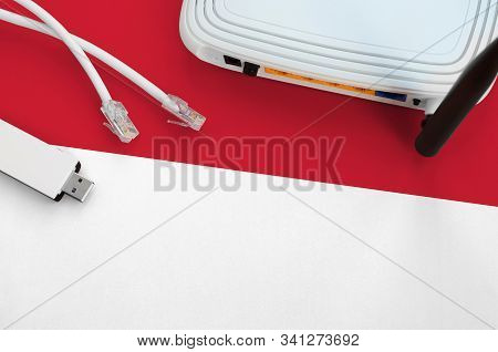 Monaco Flag Depicted On Table With Internet Rj45 Cable, Wireless Usb Wifi Adapter And Router. Intern