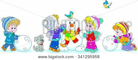 Happy Little Kids Making Big Snow Balls And Sculpting A Friendly Smiling Funny Snowman With A Colorf