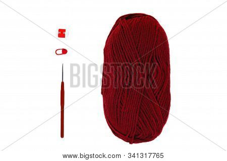 Knitting And Crocheting Flatlay.burgundy Yarn Skein, Crochet Hook, Row Counter On White Background I