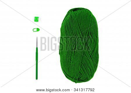Knitting And Crocheting Flatlay.green Yarn Skein, Crochet Hook, Row Counter On White Background Isol